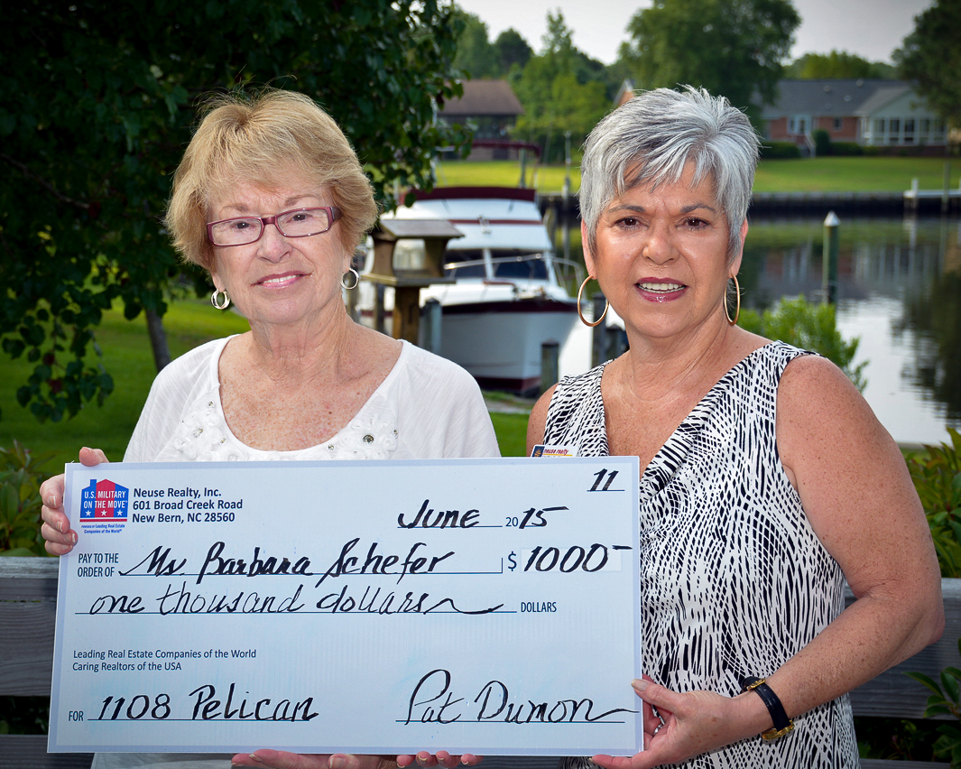 Above is the photo of the 11th MOM® recipient with the NRI agent, Pat Dumon.