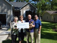 Pat Rich and Howard Neviser present Rebate Check